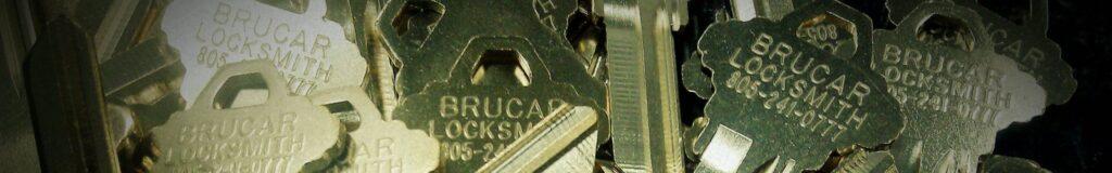 "Blank keys engraved with ""Brucar Locksmith"""